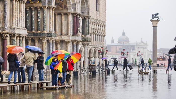 Piazza (square) San Marco with the Colonna (Column) di San Marco during the Acqua Alta (High Tide), on the background the Church of San Giorgio Maggiore