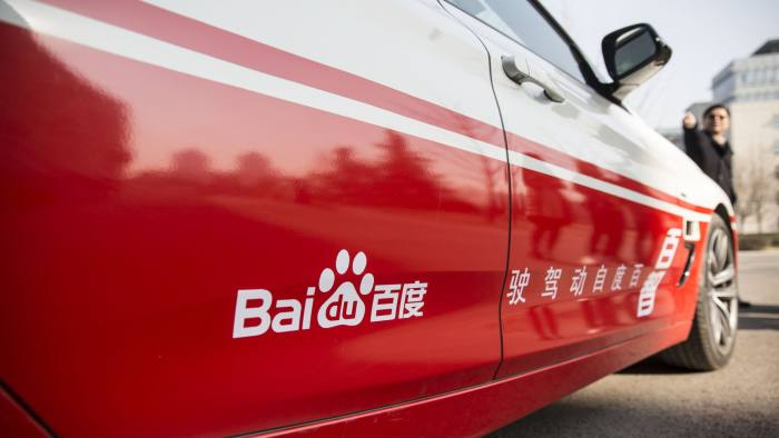 A Baidu Inc. logo is displayed on the company's autonomous car at the company's headquarters in Beijing, China, on Tuesday, Jan. 19, 2016. Wang Jing, the senior vice president in charge of Baidu's autonomous driving efforts, is on a mission: To push China to the forefront of the coming driverless-car era. He thinks the company can leverage its expertise in artificial intelligence, data mapping and Internet connectivity to excel in autonomous driving technology. Photographer: Qilai Shen/Bloomberg