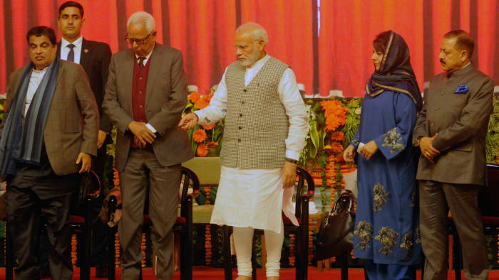 SRINAGAR, INDIA - MAY 19: Prime Minister Narendra Modi along with J&K Chief Minister Mehbooba Mufti, Governor N.N. Vohra, Union Minister Jitendra Singh and Union Minister for Road Transport and Highways Nitin Gadkari during a function to inaugurate the Kishanganga Hydroelectric Power Station in the state of Jammu and Kashmir, amid protests from neighbour Pakistan which says the project on a river flowing into Pakistan will disrupt water supplies, at Sher-i-Kashmir International Conference Centre (SKICC), on May 19, 2018 in Srinagar, India. Modi, who is on a day-long visit to the state, also flagged off the construction of the 14 km (9 mile)-long Zojila tunnel to provide all-weather connectivity between the cities of Srinagar, Kargil and Leh. (Photo by Waseem Andrabi/Hindustan Times via Getty Images)