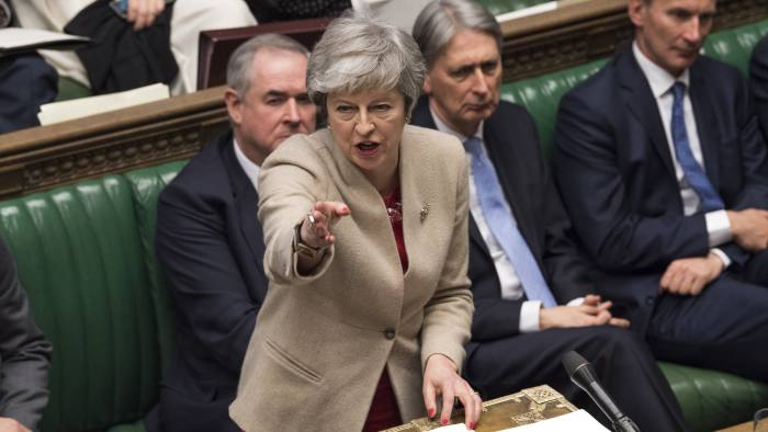 A handout photograph taken and released by the UK Parliament on March 29, 2019 shows Britain's Prime Minister Theresa May listening to a speaker during a a debate in the House of Commons on the Government's Withdrawal Agreement Bill