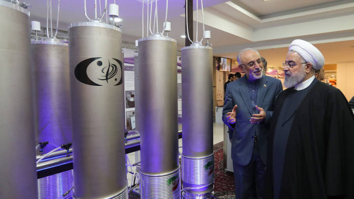 """(FILES) In this file photo made available on April 09, 2019 by the Iranian presidential office, Iranian President Hassan Rouhani (2nd L) listens to head of Iran's nuclear technology organisation Ali Akbar Salehi (R) during the """"nuclear technology day"""" in Tehran. - Iran will no longer respect limits it agreed on its enriched uranium and heavy water stocks under a 2015 nuclear deal with major powers, officials said on May 8, 2019. Iran's Supreme National Security Council said the measure was necessary to """"secure its rights and bring back balance"""" after Washington's abandonment of the agreement exactly one year ago on May 8, 2018. (Photo by HO / Iranian Presidency / AFP) / === RESTRICTED TO EDITORIAL USE - MANDATORY CREDIT """"AFP PHOTO / HO / IRANIAN PRESIDENCY"""" - NO MARKETING NO ADVERTISING CAMPAIGNS - DISTRIBUTED AS A SERVICE TO CLIENTS ===HO/AFP/Getty Images"""
