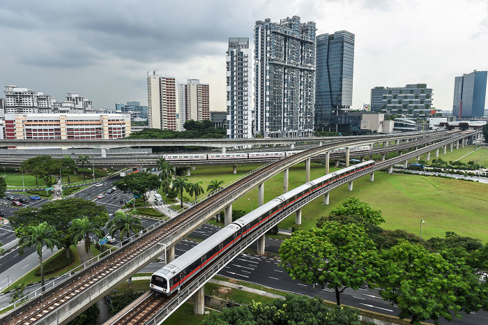 Singapore Mass Rapid Transit (SMRT) trains ply along lines at the Jurong East interchange (back R) in Singapore on July 18, 2016. / AFP / ROSLAN RAHMAN (Photo credit should read ROSLAN RAHMAN/AFP/Getty Images)