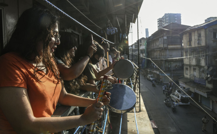 In response to the call of Prime Minister Narenda Modi, a group of women come out onto their apartment's balcony clapping and banging dishes in a display of thanks and support for the emergency services on the frontline fighting the coronavirus outbreak.