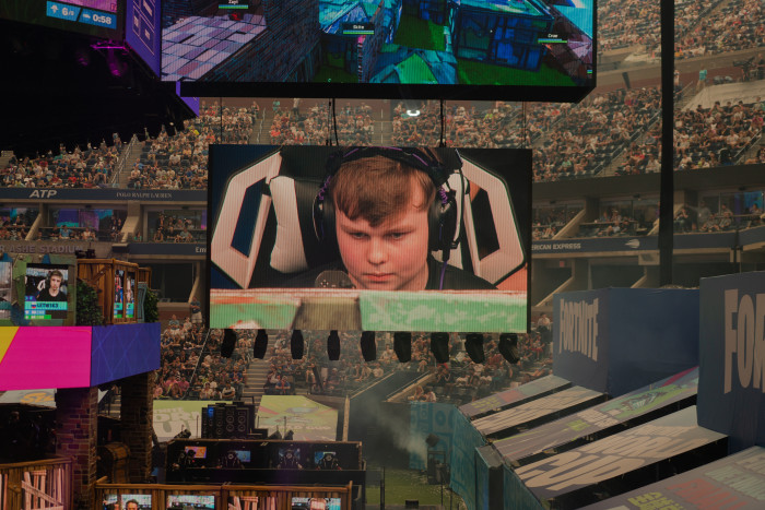 BenjyFishy, a British 'Fortnite' player who commands 200,000 followers on the streaming platform Twitch, is displayed on the big screen. Photographed for the FT by Patrick Driscoll