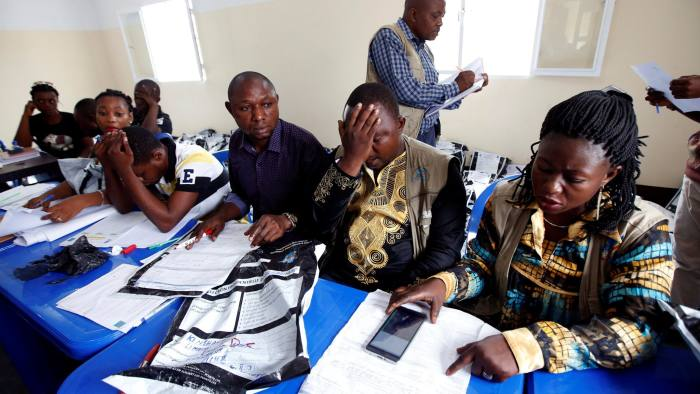 Congo's Independent National Electoral Commission (CENI) officials check presidential elections polling stations voting forms at tallying centre in Kinshasa, Democratic Republic of Congo, January 4, 2019. REUTERS/Baz Ratner