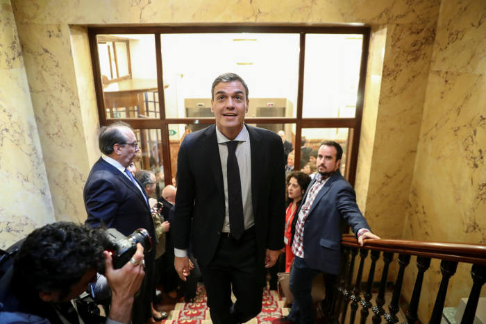 Spain's new Prime Minister and Socialist party (PSOE) leader Pedro Sanchez leaves the chamber after a motion of no confidence vote at parliament in Madrid, Spain, June 1, 2018. REUTERS/Sergio Perez TPX IMAGES OF THE DAY