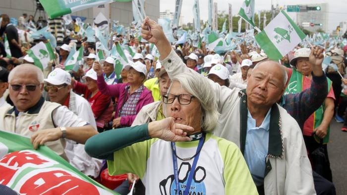 Pro-independence demonstrators shout slogans during a rally in Taipei, Taiwan, Saturday, Oct. 20, 2018. Thousands of the demonstrators gathered in Taiwan's capital on Saturday to express their disapproval with China's stance toward their island. (AP Photo/Chiang Ying-ying)
