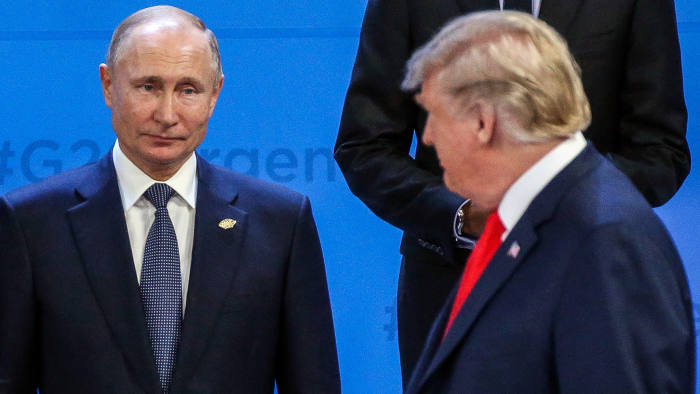 BUENOS AIRES, ARGENTINA - NOVEMBER,30 (RUSSIA OUT) U.S. President Donald Trump (R) looks on Russian President Vladimir Putin (L) during the family photo at the G20 Summit's Plenary Meeting in Buenos Aires, Argentina, November,30,2018. U.S.Preisident Donald Trump has cancelled his meeting with Vladimir Putin at the G20 Summit in Argentina planned on Saturday. (Photo by Mikhail Svetlov/Getty Image