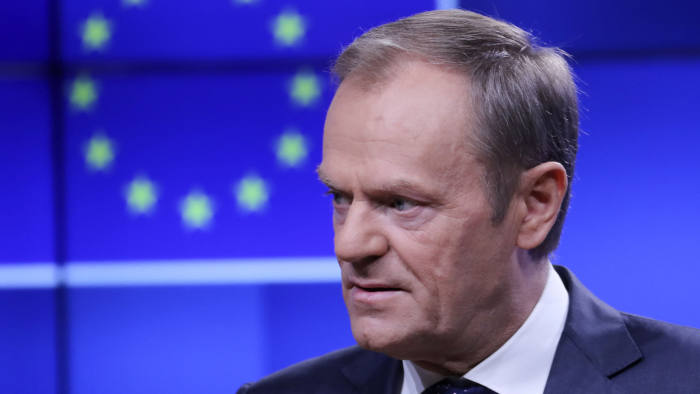 epa07166474 European Union Council President Donald Tusk attends an event to receive a copy of a draft Brexit withdrawal agreement in Brussels, Belgium, 15 November 2018. The British cabinet has backed the draft Brexit withdrawal agreement. EPA-EFE/OLIVIER HOSLET