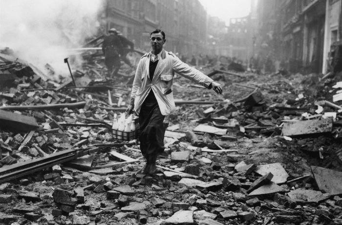 A milkman delivers milk amid the ruins in Holborn, London