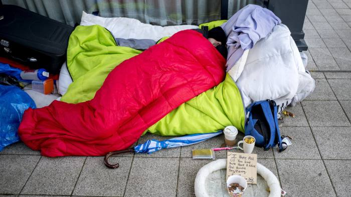 A homeless person is seen sleeping rough in Milton Keynes town centre on November 24, 2017.