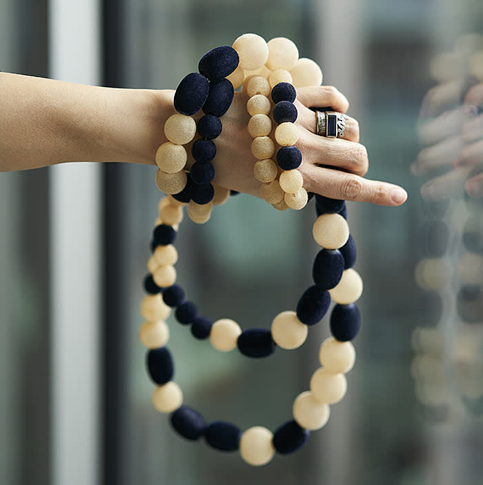 Sandra Choi at Jimmy Choo 10 Howick Place SW1P 1GW London for Financial Times; Blue and white flocked necklace bought from a market in Rio