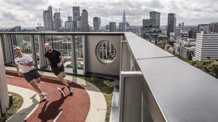 City workers exercise on the rooftop running track of the White Collar Factory in view of skyscrapers in the City of London, U.K., on Monday, Sep. 11, 2017. Asian investors are paying record prices for London office buildings after the devaluation of the pound in the wake of last year's Brexit vote. Photographer: Jason Alden/Bloomberg