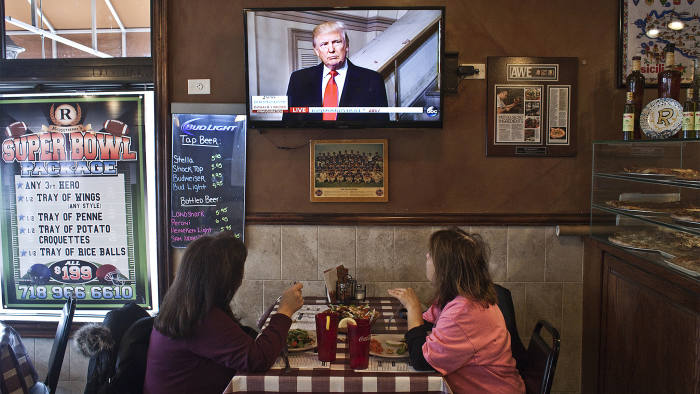 Customers watch television on the day of Donald Trump's presidential inauguration, at W's Bar and Restaurant, on Staten Island in New York, Jan. 20, 2017. The owners are Trump supporters. (Bryan Anselm/The New York Times) Credit: New York Times / Redux / eyevine For further information please contact eyevine tel: +44 (0) 20 8709 8709 e-mail: info@eyevine.com www.eyevine.com