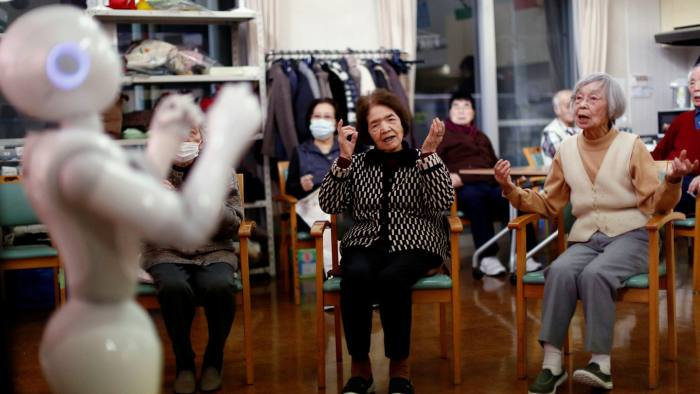 "Residents follow moves made by humanoid robot 'Pepper' during an afternoon exercise routine at Shin-tomi nursing home in Tokyo, Japan, February 2, 2018. REUTERS/Kim Kyung-Hoon SEARCH ""KYUNG-HOON ROBOTS"" FOR THIS STORY. SEARCH ""WIDER IMAGE"" FOR ALL STORIES. - RC1C10C49A70"