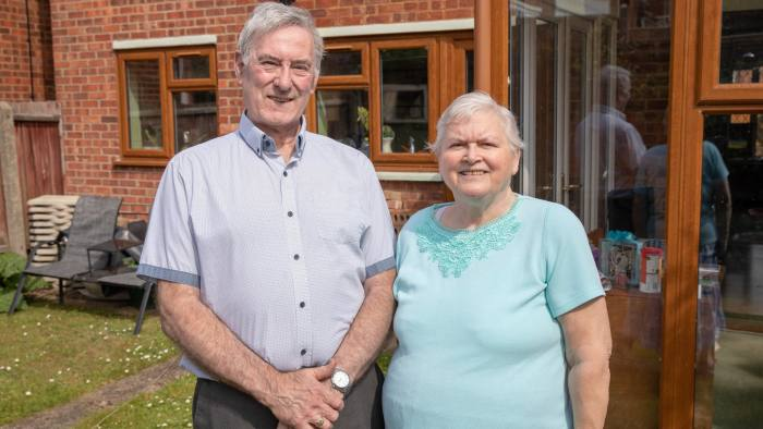 Trevor and Ruth Stamp photographed at their Ipswich home for an FT Money piece about equity release. There are solar panels on their roof in the background. PHOTOGRAPH BY DANIEL JONES 2019 07815 853503 info@danieljonesphotography.co.uk www.danieljonesphotography.co.uk