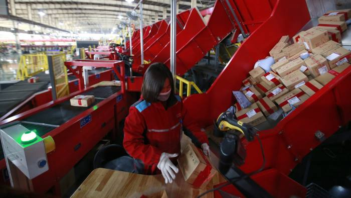 epa06321743 Chinese workers sort packages on a conveyor belt at a sorting centre for JD.com on Singles Day, otherwise known as '11.11' Global Shopping Festival, in Beijing, China, 11 November 2017. Singles Day is the largest online shopping festival in the world and Chinese consumers are expected to spend billions on bargains during the one-day e-commerce shopping spree. EPA-EFE/HOW HWEE YOUNG