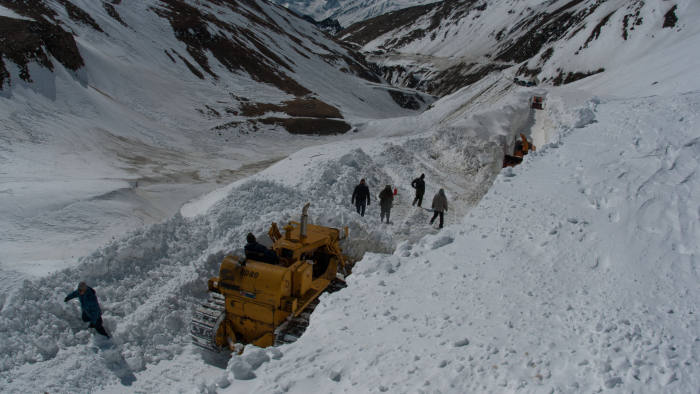 SRINAGAR, KASHMIR, INDIA - MARCH 03: Snow cutters of Indian Border Roads Organisation clearing snow from Srinagar-Leh Highway on a treacherous pass which remains snow bound for most of the time is likely to open early this year mostly because of less snowfall and dry weather on March 03, 2016 in Zojila, 108 km east of Srinagar, the summer capital of Indian administered Kashmir, India. Snow clearance begins on the 443 km long Srinagar Leh Highway and is expected to be thrown open by ending March this year as per Indian Border Roads Organisation. The highway remains snowbound for most of the time due to accumulation of snow on Zojila pass which connects Kashmir with Ladakh region a famous tourist destination among foreign tourists for its monasteries, landscapes and mountains. The average snow buildup on the rocky territory of Zojila pass normally stays in the level of 15 to 25 meters and is closed for a half of each year. It opens up in late spring and travelers on the pass have to withstand snowstorms, fierce air currents, cold and highly dangerous circumstances. (Photo by Yawar Nazir/Getty Images)