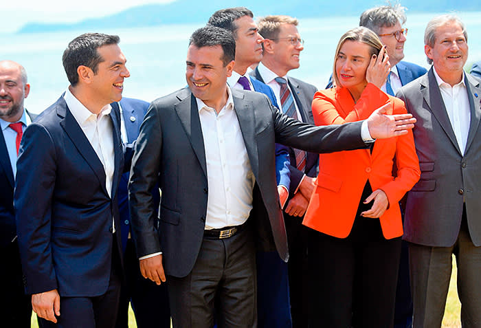 Macedonian Prime Minister Zoran Zaev (2ndL) welcomes Greek Prime Minister Alexis Tsipras (L), High Representative of the European Union for Foreign Affairs and Security Policy Federica Mogherini (2ndR) and European Commissioner for European Neighbourhood Policy and Enlargement Negotiations Johannes Hahn (R) on the shore of the Lake Prespa near Otesevo on June 17, 2018. - The foreign ministers of Greece and Macedonia signed a historic preliminary accord to end a 27-year bilateral row by renaming Macedonia to Republic of North Macedonia. (Photo by Maja ZLATEVSKA / AFP) (Photo credit should read MAJA ZLATEVSKA/AFP/Getty Images)