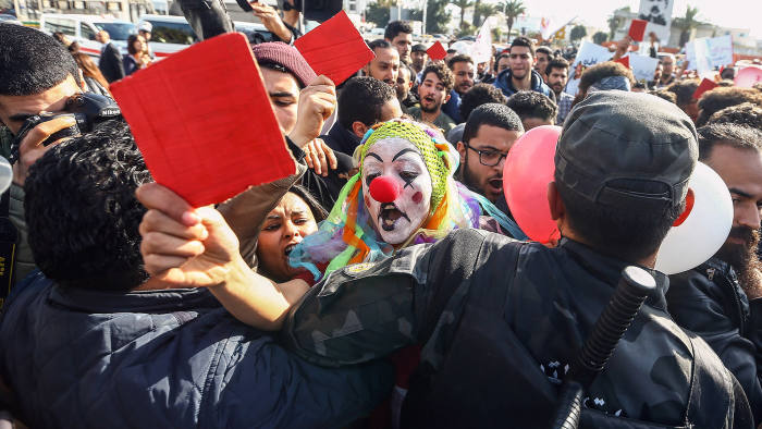 TUNIS, TUNISIA - JANUARY 26: A demonstrator, wearing a clown costume, from Tunisia's 'Fech Nestannew' (What are we waiting for?) youth movement attends a protest against high cost of living after the new budget law outside the Parliament building in Tunis, Tunisia on January 26, 2018. (Photo by Yassine Gaidi/Anadolu Agency/Getty Images)