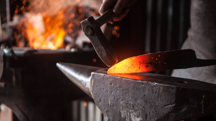 A blacksmith works on a knife in 'Metal', one of three documentaries in the 'Handmade' series