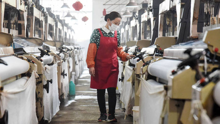 This photo taken on April 29, 2020 shows an employee working at a textile factory in Handan in China's northern Hebei province. - Chinese factory activity continued to expand in April, data showed on April 30, but analysts warned that the outlook remained clouded by battered overseas demand as the rest of the world struggles to overcome the coronavirus pandemic. (Photo by STR / AFP) / China OUT (Photo by STR/AFP via Getty Images)
