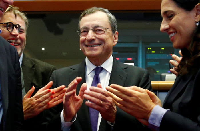 European Central Bank (ECB) President Mario Draghi is applauded by members of the European Parliament's Economic and Monetary Affairs Committee in Brussels, Belgium September 23, 2019. REUTERS/Francois Lenoir