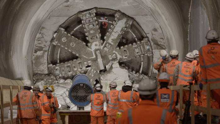 A workman is seen through a drill after the Crossrail breakthrough into the east end of Crossrail's Liverpool Street station in London.