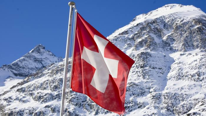 Swiss falg and mountain
