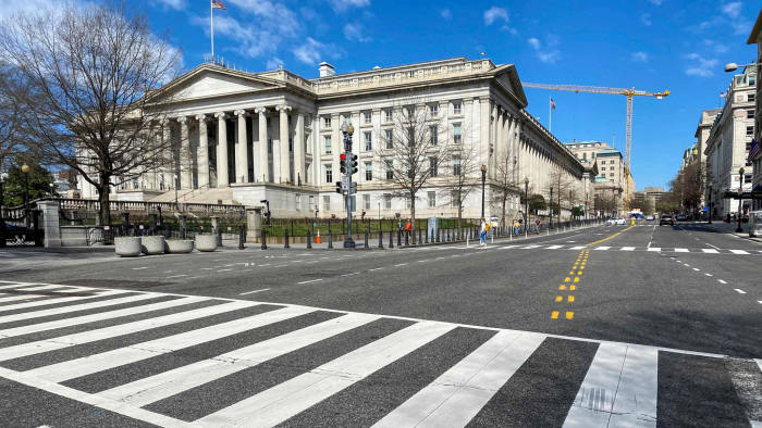 The US Treasury Department building is seen next to an almost empty 15th Street at noon in Washington DC on March 13, 2020. - Fear of the coronavirus spread reduced traffic and usual activity in the US Capital to a standstill. The World Health Organization said Friday it was not yet possible to say when the COVID-19 pandemic, which has killed more than 5,000 people worldwide, will peak. (Photo by Eric BARADAT / AFP) (Photo by ERIC BARADAT/AFP via Getty Images)