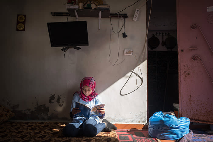 Picture by Charlie Bibby/Financial Times Financial Times seasonal appeal. Habitat for Humanity in Lebanon with Chloe Cornish. Pictures shows: Lara, the daughter of Abu Suleiman in the Shatila refugee slum For FT magazine.