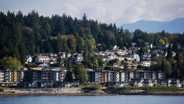 Residential condo buildings and single family houses are seen above Burrard Inlet in North Vancouver, British Columbia, Canada, on Wednesday, Sept. 19, 2018. U.S. Trade Representative Robert Lighthizer and Canadian Foreign Minister Chrystia Freeland met Thursday in Washington to negotiate Nafta talks, but no agreement was reached. Photographer: Darryl Dyck/Bloomberg via Getty Images