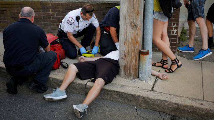 Cataldo Ambulance medics and other first responders revive a 32-year-old man who was found unresponsive and not breathing after an opioid overdose on a sidewalk in the Boston suburb of Everett, Massachusetts, U.S., August 23, 2017. REUTERS/Brian Snyder SEARCH