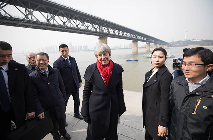Theresa May, U.K. prime minister, center, leaves after speaking with environmental experts during a visit to the Yangtze river in Wuhan, China, on Wednesday, Jan. 31, 2018. Mayarrived in China seeking to balance her desire to build a powerful post-Brexit trade relationship with a clutch of political concerns. Photographer: Chris Ratcliffe/Bloomberg