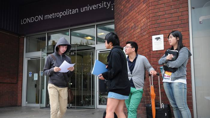 Foreign students and advisors are pictured outside a campus of the London Metropolitan University in London, on August 30, 2012. Thousands of overseas students on Thursday faced possible deportation from Britain after the government stripped a London university of its right to sponsor their visas. Amid alarm at the potential damage to the foreign student market in Britain -- worth an estimated £14 billion (17.7 billion euros, $22.2 billion) -- the government rushed to reassure foreign students that it was an isolated case. AFP PHOTO / CARL COURT (Photo credit should read CARL COURT/AFP/GettyImages)