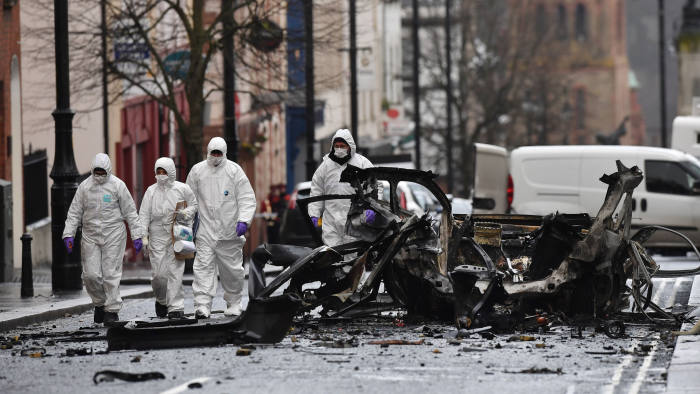 LONDONDERRY, NORTHERN IRELAND - JANUARY 20: Forensic officers inspect the remains of the van used as a car bomb on an attack outside Derry Court House on January 20, 2019 in Londonderry, Northern Ireland. Dissident republicans are suspected to have carried out the attack which has been condemned by Northern Ireland politicians. (Photo by Charles McQuillan/Getty Images)