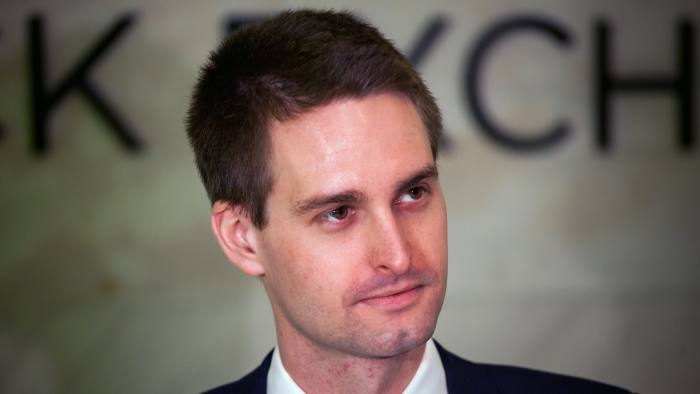 Evan Spiegel, co-founder and chief executive officer of Snap Inc., stands on the floor of the New York Stock Exchange (NYSE) during the company's initial public offering (IPO) in New York, U.S., on Thursday, March 2, 2017. Snap Inc., maker of the disappearing photo app that relies upon the fickle favor of millennials, jumped in its trading debut after pricing its initial public offering above the marketed range. Photographer: Michael Nagle/Bloomberg