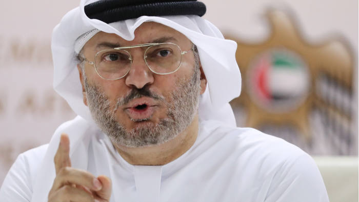 """Emirati Foreign Minister Anwar Gargash speaks during a press conference in Dubai on June 18, 2018. - The United Arab Emirates, part of a Saudi-led Arab military alliance in Yemen, warned Huthi rebels to withdraw from the key port city of Hodeida as coalition-backed government forces advance. The """"Hodeida port operation will continue unless rebels withdraw unconditionally,"""" Gargash told a press conference in Dubai. (Photo by KARIM SAHIB / AFP) (Photo credit should read KARIM SAHIB/AFP/Getty Images)"""