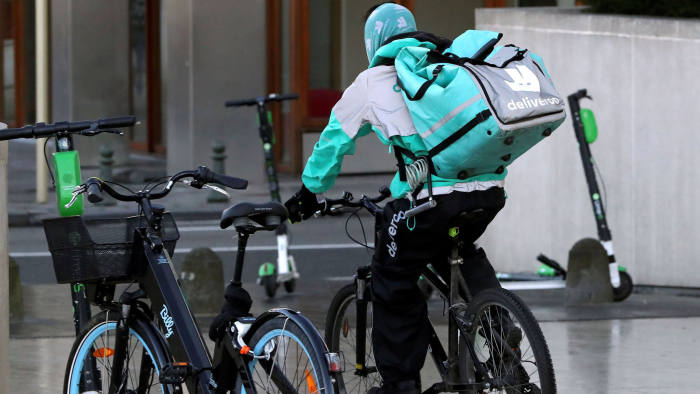 FILE PHOTO: A courier for food delivery service Deliveroo rides a bike in central Brussels, Belgium January 16, 2020. Picture taken January 16, 2020. REUTERS/ Yves Herman/File Photo/File Photo