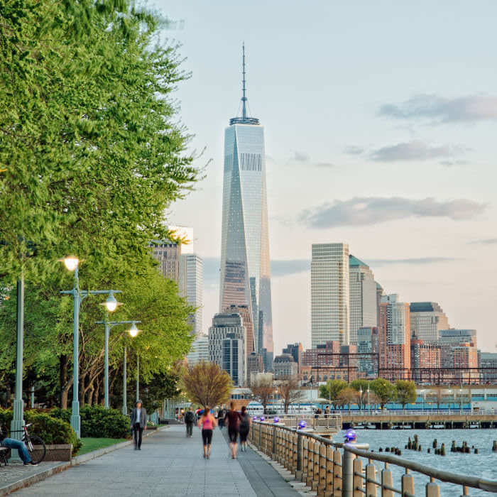 Running along the banks of Hudson River with glimpses of Freedom Tower Getty Images