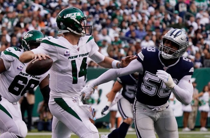 Oct 13, 2019; East Rutherford, NJ, USA; New York Jets quarterback Sam Darnold (14) looks to throw under pressure from Dallas Cowboys defensive end Robert Quinn (58) at MetLife Stadium. Mandatory Credit: Robert Deutsch-USA TODAY Sports