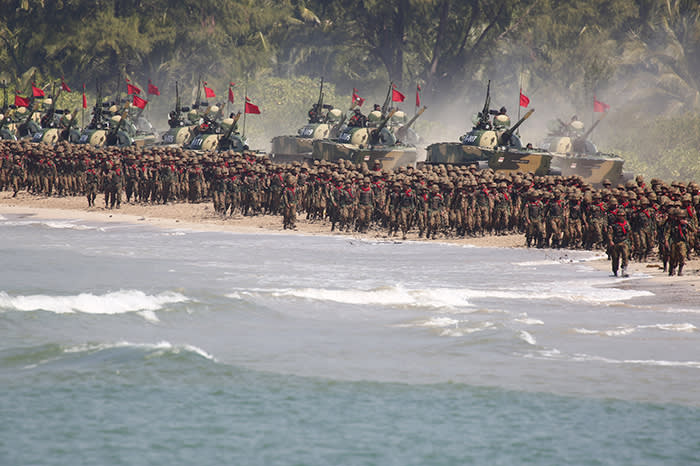 Myanmar military troops and tanks move in formation along the shore during the second day of 'Sin Phyu Shin' joint military exercises in Ayeyarwaddy delta region, on February 3, 2018. The two-day military exercise is the biggest since 1997, involving different armed forces divisions. / AFP PHOTO / POOL / LYNN BO BO (Photo credit should read LYNN BO BO/AFP/Getty Images)