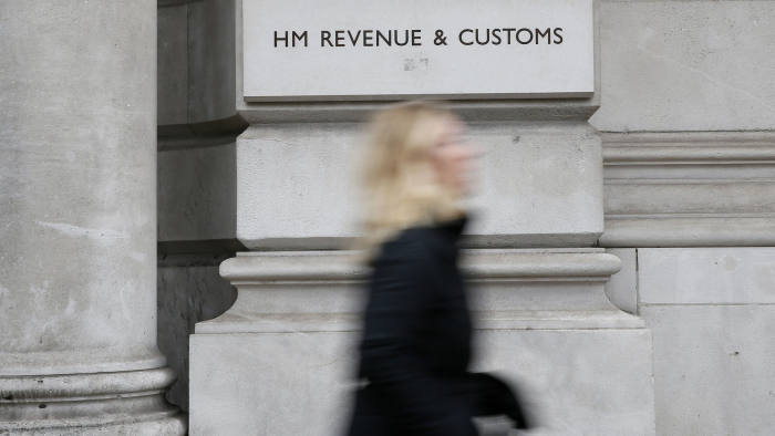 A pedestrian walks past the headquarters of Her Majesty's Revenue and Customs (HMRC) in central London February 13, 2015. British lawmakers plan to call up the bosses of HSBC and the tax authority, HMRC, to quiz them over allegations some clients of HSBC's Swiss private bank evaded tax.     REUTERS/Stefan Wermuth (BRITAIN - Tags: BUSINESS POLITICS CRIME LAW) - LM1EB2D127201