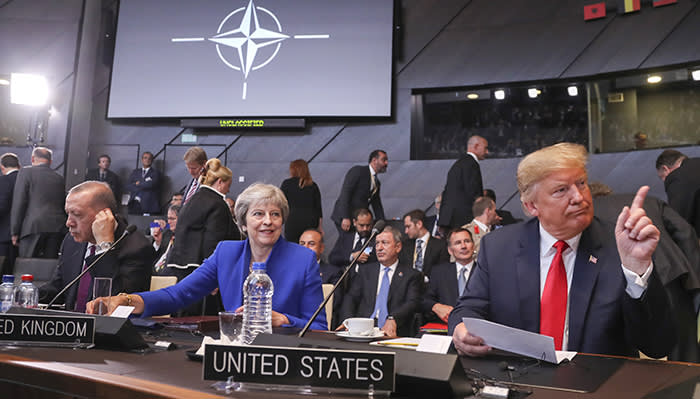epa06880375 (L-R) Turkish President Recep Tayyip Erdogan, British Prime Minister Theresa May, and US President Donald J. Trump before the start of the North Atlantic Council round table during a NATO summit in Brussels, Belgium, 11 July 2018. NATO countries' heads of states and governments gather in Brussels for a two-day meeting. EPA/OLIVIER HOSLET