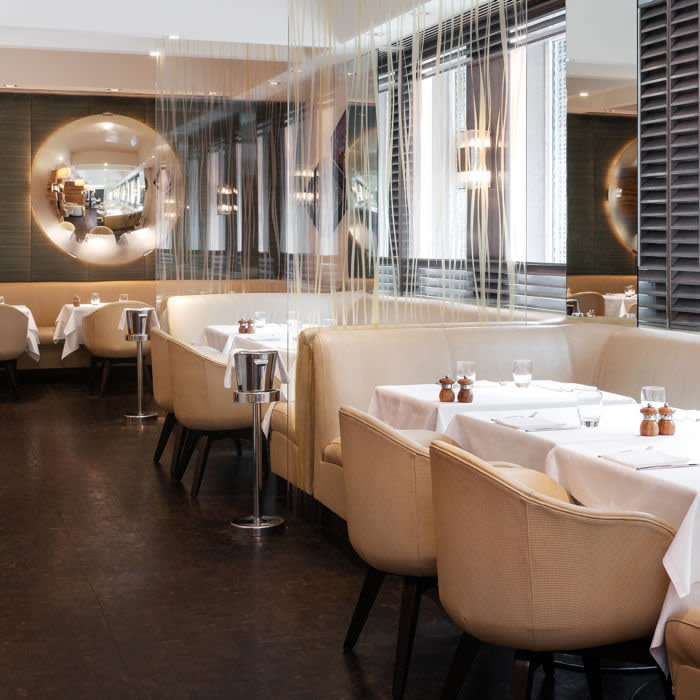 The restaurant's mix of seating means that you can opt to be on show or dine discreetly in a closed booth