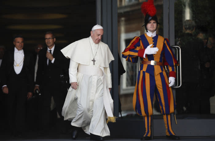Pope Francis leaves the morning session of the Amazon synod, at the Vatican, Saturday, Oct. 12, 2019. Pope Francis is holding a three-week meeting on preserving the rainforest and ministering to its native people as he fended off attacks from conservatives who are opposed to his ecological agenda. (AP Photo/Alessandra Tarantino)