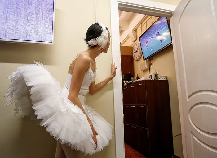 Soccer Football - World Cup - Quarter-final - Russia vs Croatia - Saint Petersburg, Russia - July 7, 2018 - A ballerina watches the broadcast of the World Cup quarter-final match between Russia and Croatia at the Mikhailovsky Theatre. REUTERS/Anton Vaganov TPX IMAGES OF THE DAY