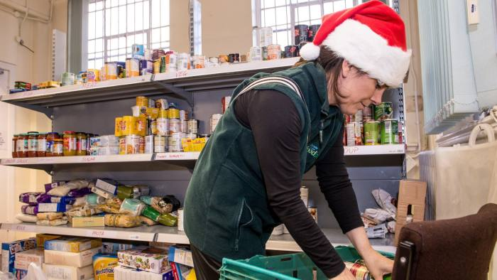 LIVERPOOL, ENGLAND - DECEMBER 21:  A volunteer collects food from shelves to fill a client's voucher request at the Trussell Trust Food Bank on December 21, 2015 in Liverpool, England. The Trussell Trust has seen a rise in foodbank use in the period April to September 2015 with problems with the social security safety net being the biggest reason people are referred for emergency food.  The Big Lottery Fund has contributed £748,423 to the Trust as it prepares for what is likely to be record levels of demand this Christmas.  (Photo by Richard Stonehouse/Getty Images)