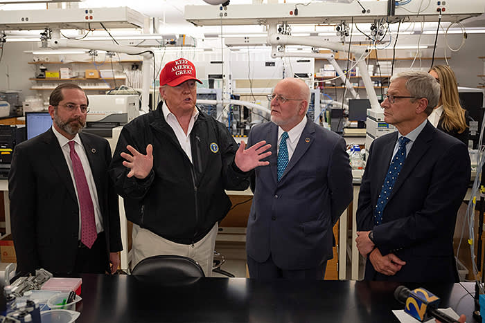 Donald Trump at the Centers for Disease Control and Prevention in Atlanta on March 6 with, from left, Alex Azar, secretary of health and human services, Robert Redfield, CDC director, and Steve Monroe, associate director for laboratory science and safety at the CDC