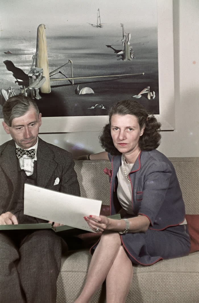 Peggy Guggenheim with Herbert Read in her London gallery, c1939, with a work by Yves Tanguy
